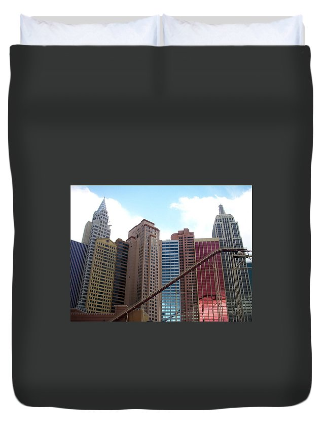 Vegas Duvet Cover featuring the photograph New York Hotel With Clouds by Anita Burgermeister