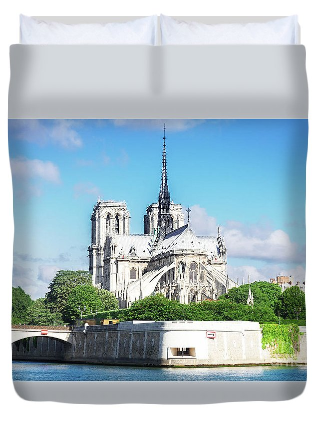 Notre-dame Duvet Cover featuring the photograph Notre Dame Over Water by Anastasy Yarmolovich