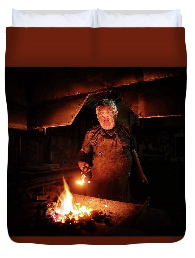 Blacksmith Duvet Cover featuring the photograph Old-fashioned Blacksmith Heating Iron by Johan Swanepoel