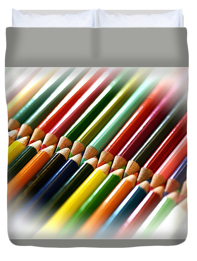 Pencils Duvet Cover featuring the photograph Opposites Attract by Arnie Goldstein