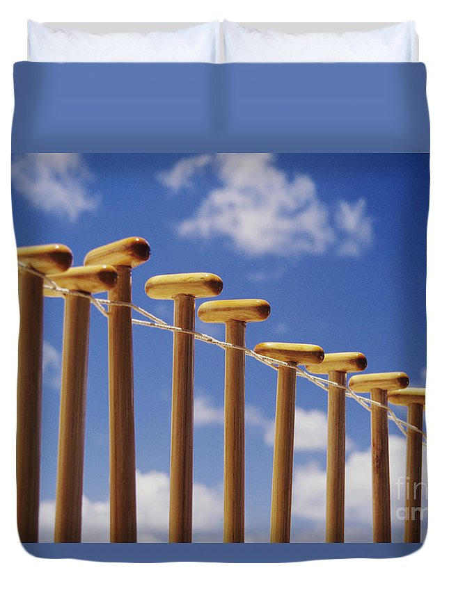 Air Duvet Cover featuring the photograph Paddles Hanging In A Row by Joss - Printscapes