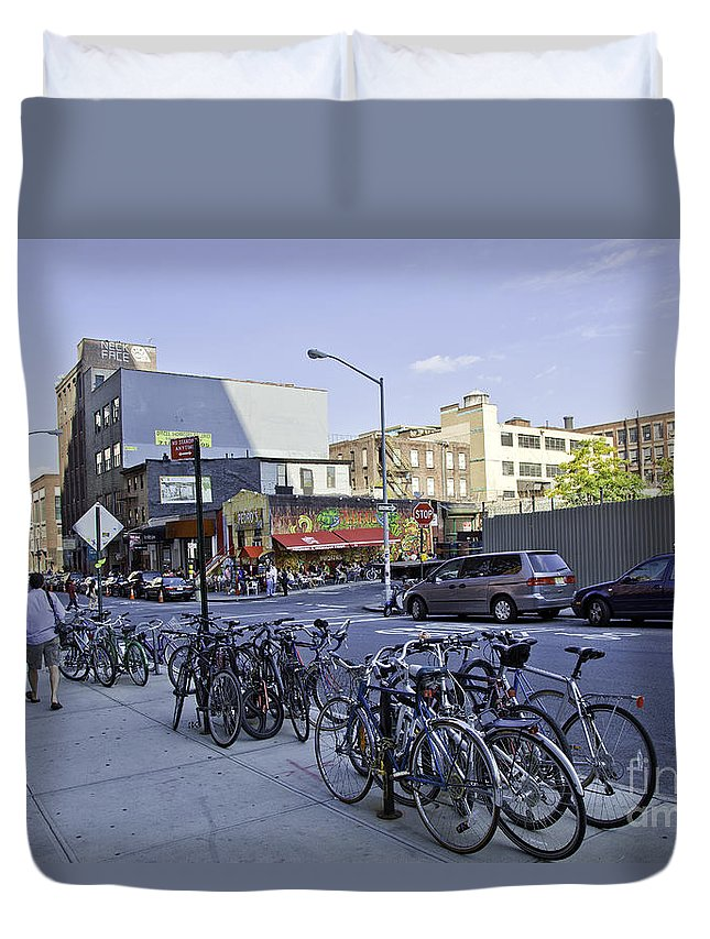 Dumbo Duvet Cover featuring the photograph Parked Bikes In Dumbo by Madeline Ellis