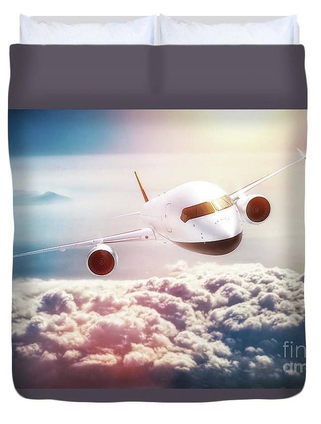 Airplane Duvet Cover featuring the photograph Passenger Airplane Flying At Sunset, Blue Sky. by Michal Bednarek