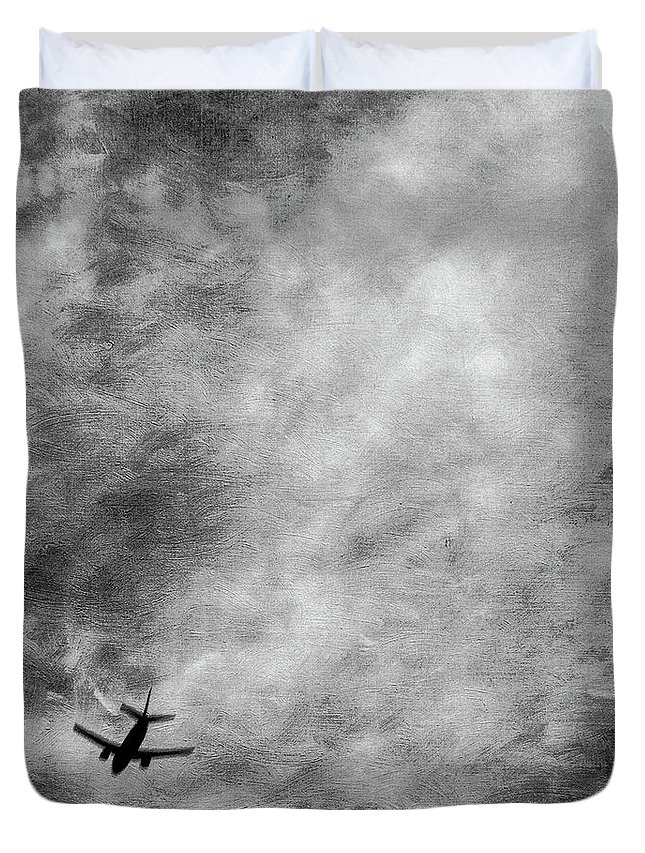 Black Duvet Cover featuring the photograph Passenger Jet Airliner Cloudy Sky Over Burbank In Bw by YoPedro