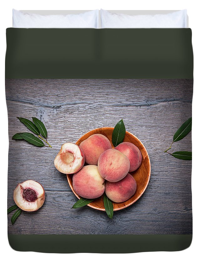 Peaches Duvet Cover featuring the photograph Peaches On A Dark Wooden Background by Sergei Dolgov