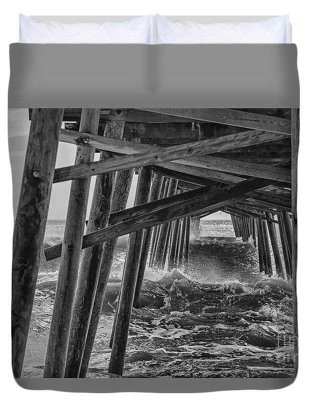 Black And White Duvet Cover featuring the photograph Pier Storm by Kelley Freel-Ebner