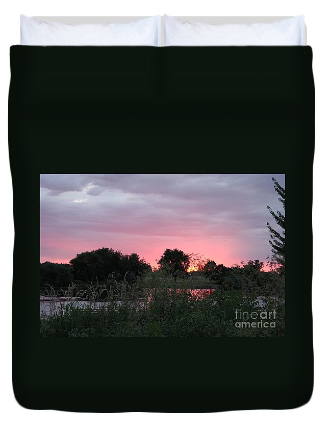 Sunset Duvet Cover featuring the photograph Pink Sunset With Green Riverbank by Carol Groenen