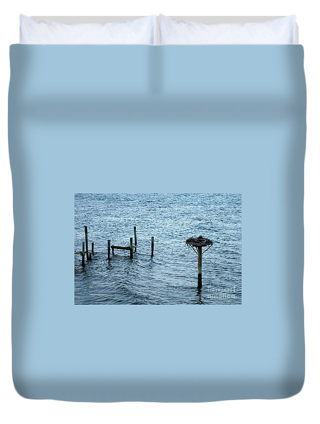 Clay Duvet Cover featuring the photograph Protected Osprey Nest by Clayton Bruster