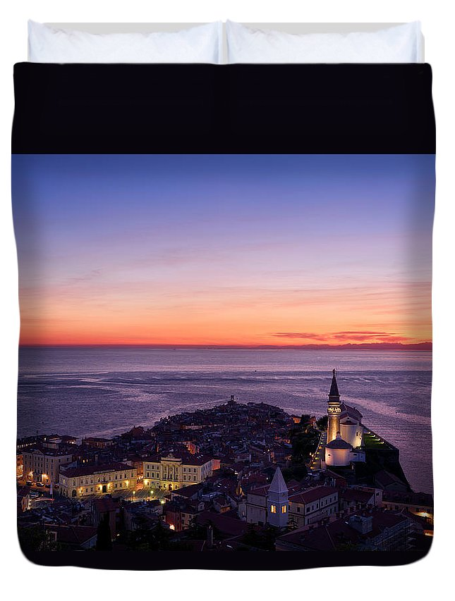 Piran Duvet Cover featuring the photograph Purple Light On The Adriatic Sea After Sundown With Lights On Pi by Reimar Gaertner