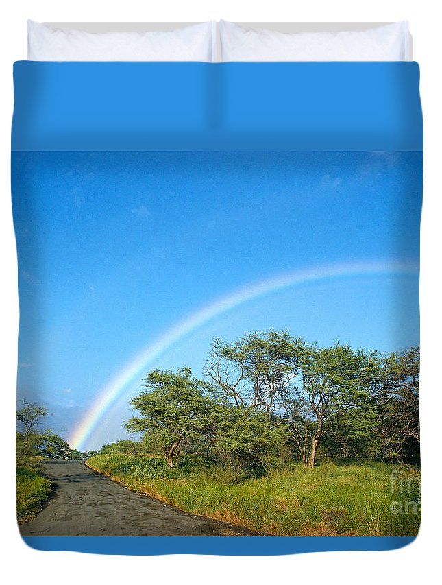 Arch Duvet Cover featuring the photograph Rainbow Over Treetops by Peter French - Printscapes