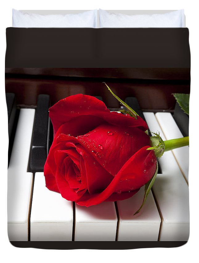 Red Rose Roses Duvet Cover featuring the photograph Red rose on piano keys by Garry Gay