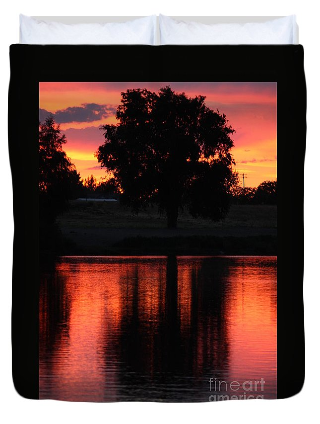 Sunset Duvet Cover featuring the photograph Red Sky Reflection With Tree by Carol Groenen