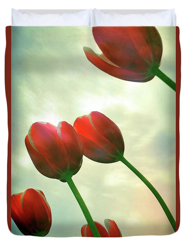 Photograph Duvet Cover featuring the photograph Red Tulips with Cloudy Sky by Michelle Calkins