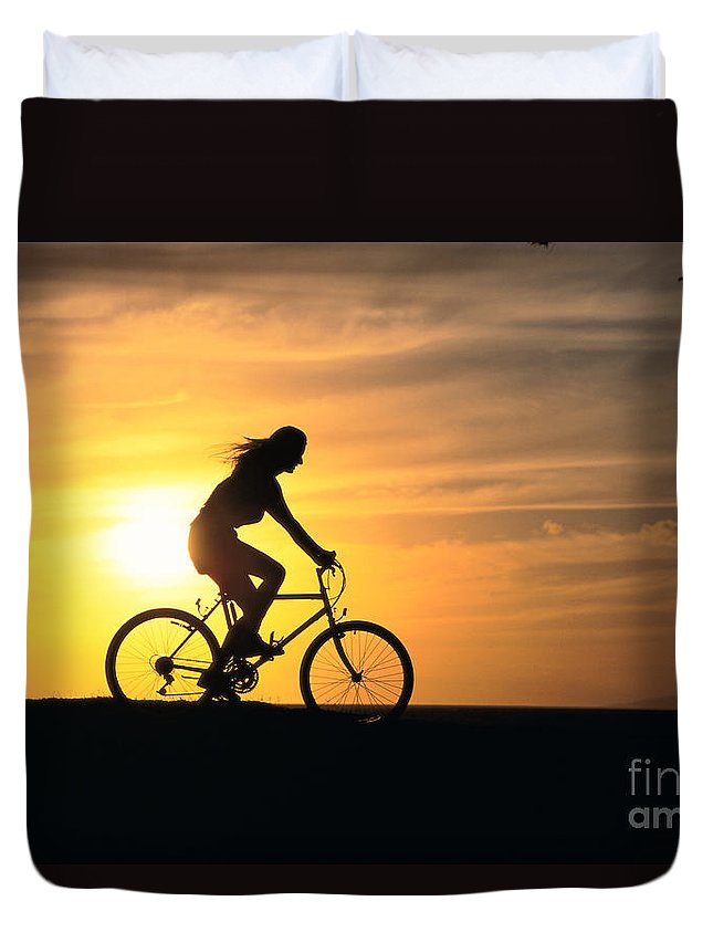 Athletic Sports Art Duvet Cover featuring the photograph Riding At Sunset by Dave Fleetham - Printscapes