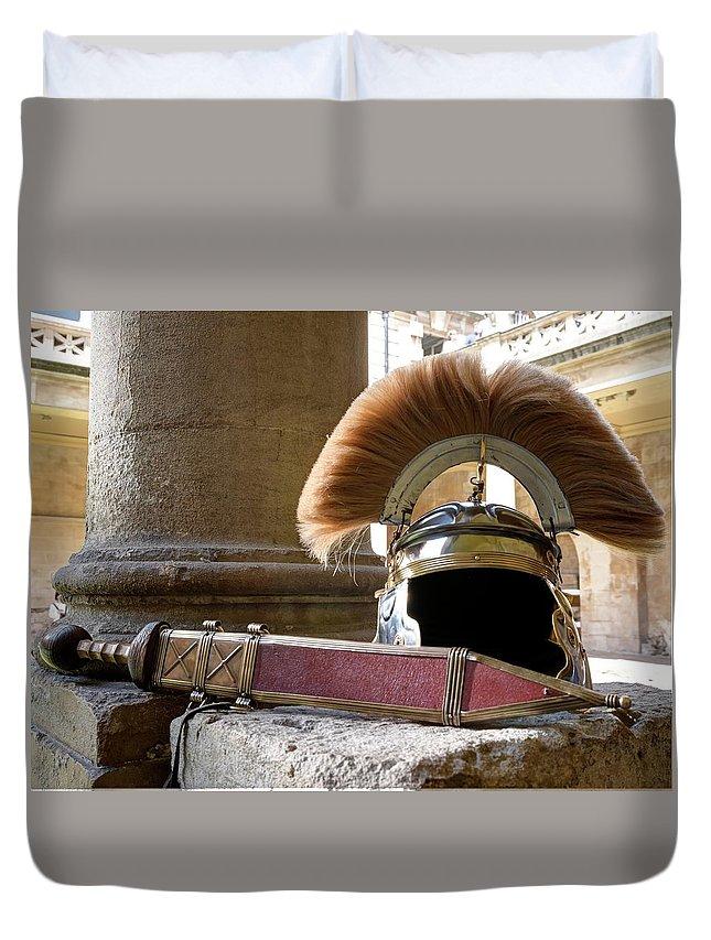Roman Duvet Cover featuring the photograph Roman Legionary Helmet And Sword by Doug Matthews