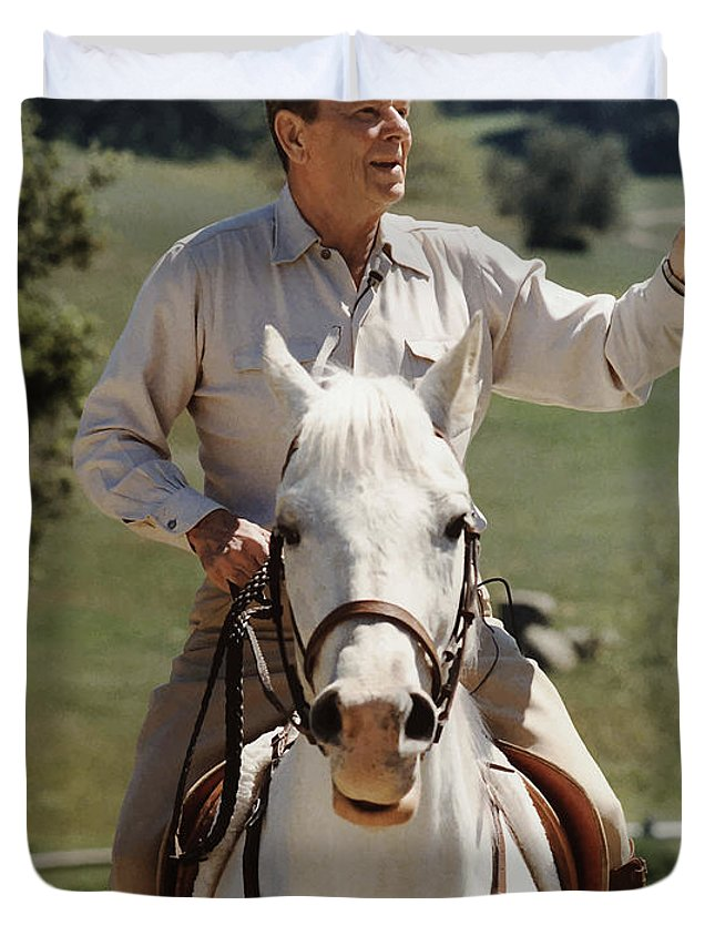 Ronald Reagan Duvet Cover featuring the photograph Ronald Reagan On Horseback by War Is Hell Store