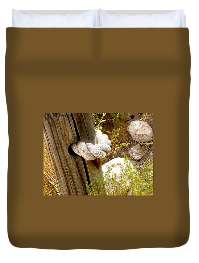 Rope Duvet Cover featuring the photograph Rope In A Post by Wayne Potrafka