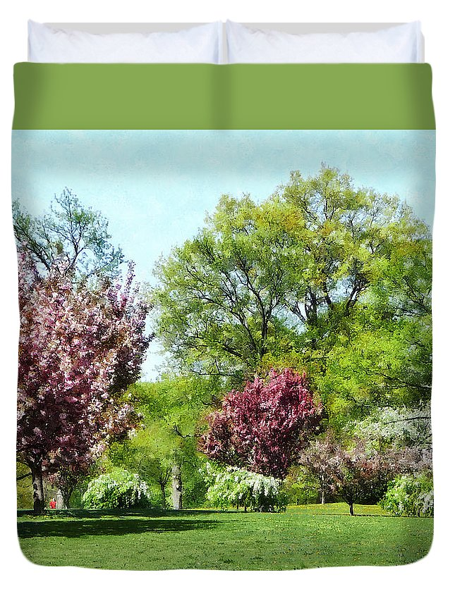 Spring Duvet Cover featuring the photograph Row Of Flowering Trees by Susan Savad
