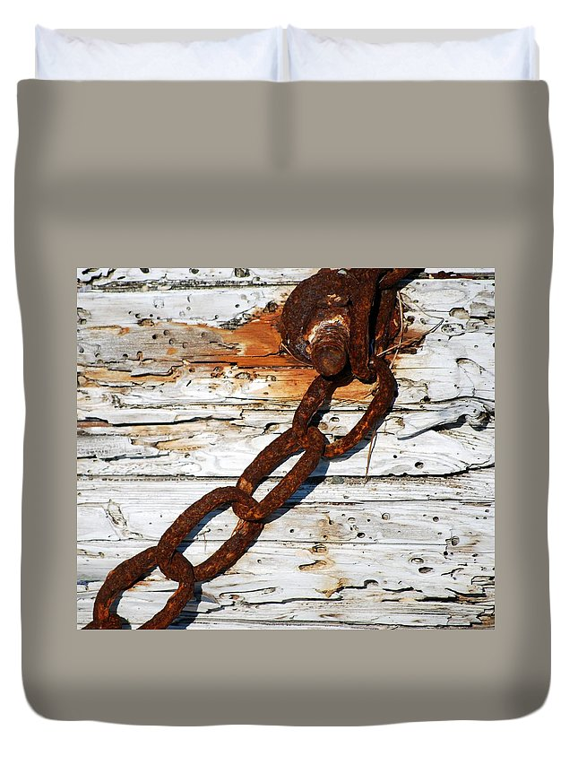 Rusted Chain On Driftwood Duvet Cover featuring the photograph Rusted Chain On Driftwood by Bill Driscoll