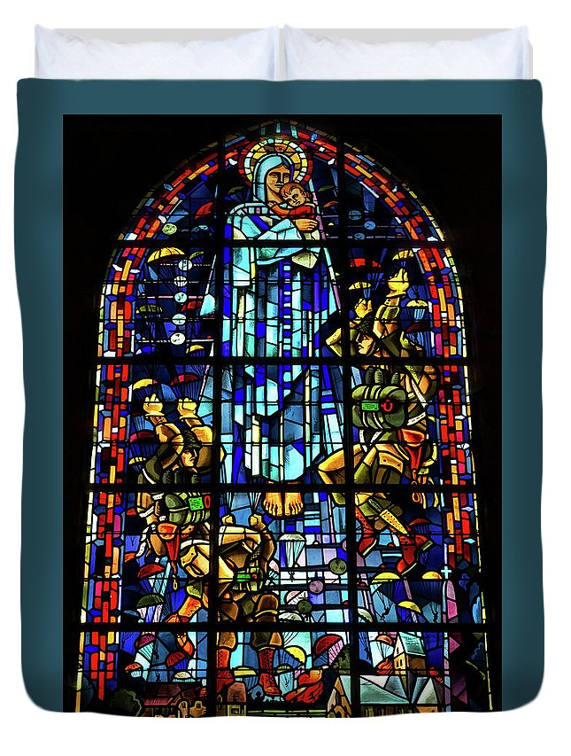 Sainte-mere-eglise Duvet Cover featuring the photograph Sainte-mere-eglise Paratrooper Tribute Stained Glass Window by John Daly