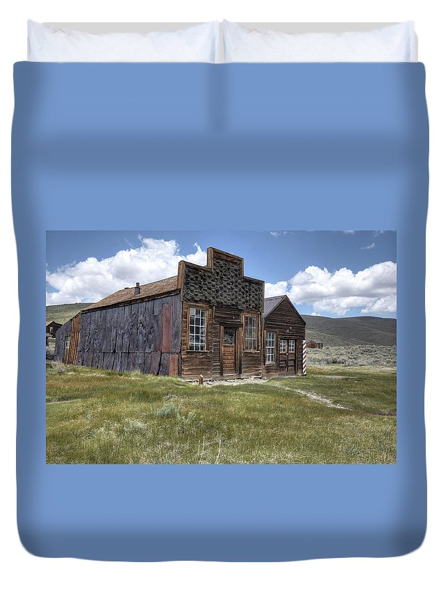 Old Rustic Historic Memories 1800's Schools Churches Bars Mercantile Blacksmith Livery Stables Nature Grass Foothills Color Red Green Blur Sky Clouds Bodie Mining Town Northern California Duvet Cover featuring the photograph Sam Leon Bar And Barber Shop by Thomas Todd