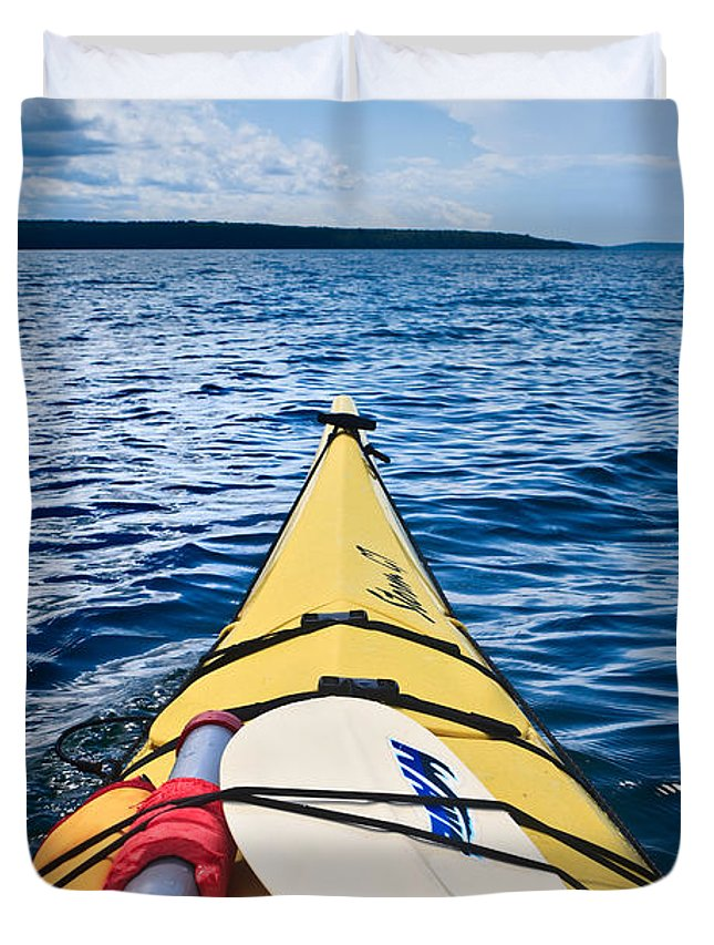 Apostle Duvet Cover featuring the photograph Sea Kayaking by Steve Gadomski