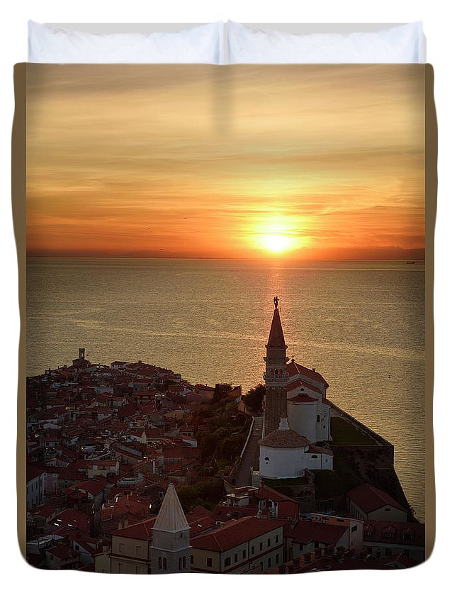 Setting Duvet Cover featuring the photograph Setting Sun On The Adriatic Sea Behind Archangel Michael On Top by Reimar Gaertner