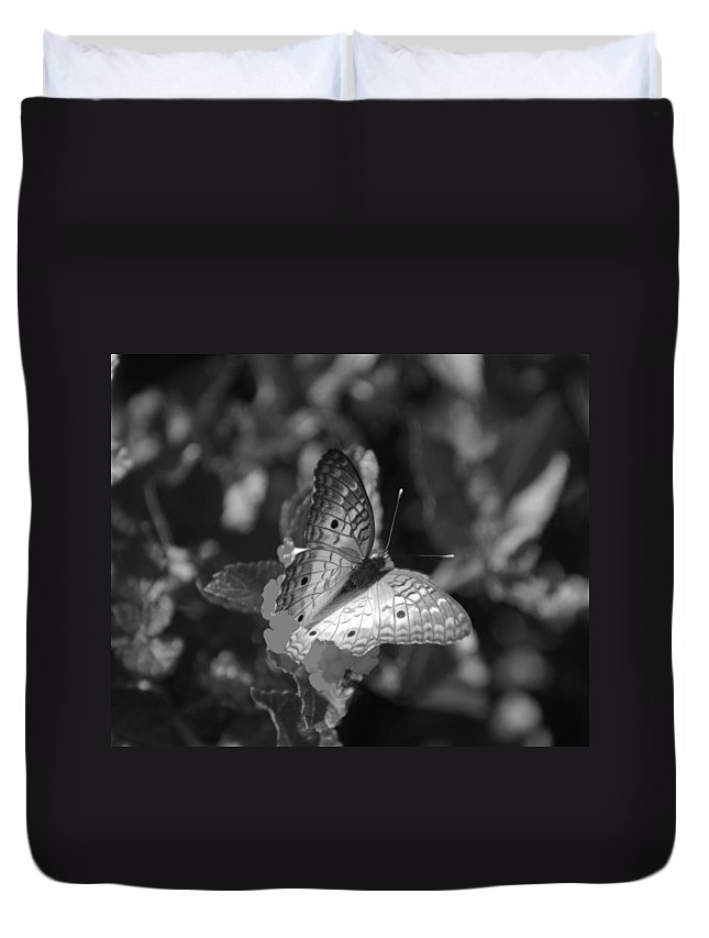 Black And White Duvet Cover featuring the photograph Shades Of Flight by Rob Hans