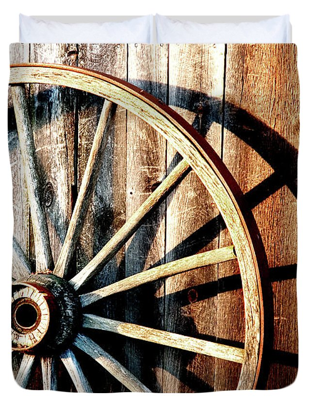 Wagon Wheel Duvet Cover featuring the photograph Shadows Of The Past by Greg Fortier