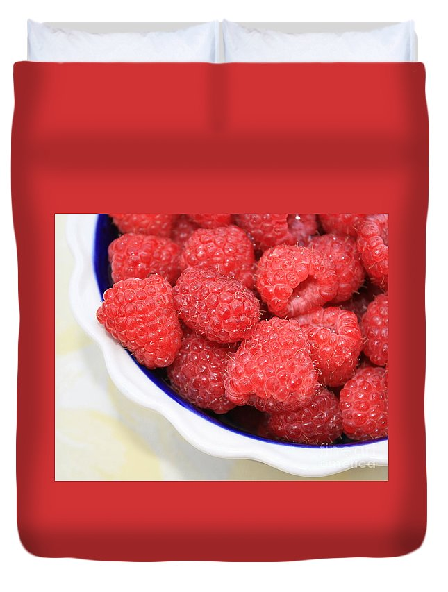 Duvet Cover featuring the photograph Side View Of Rasberries In Blue Bowl by Carol Groenen