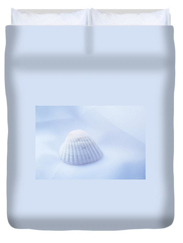 Seashell Duvet Cover featuring the photograph Simplicity by Linda Sannuti
