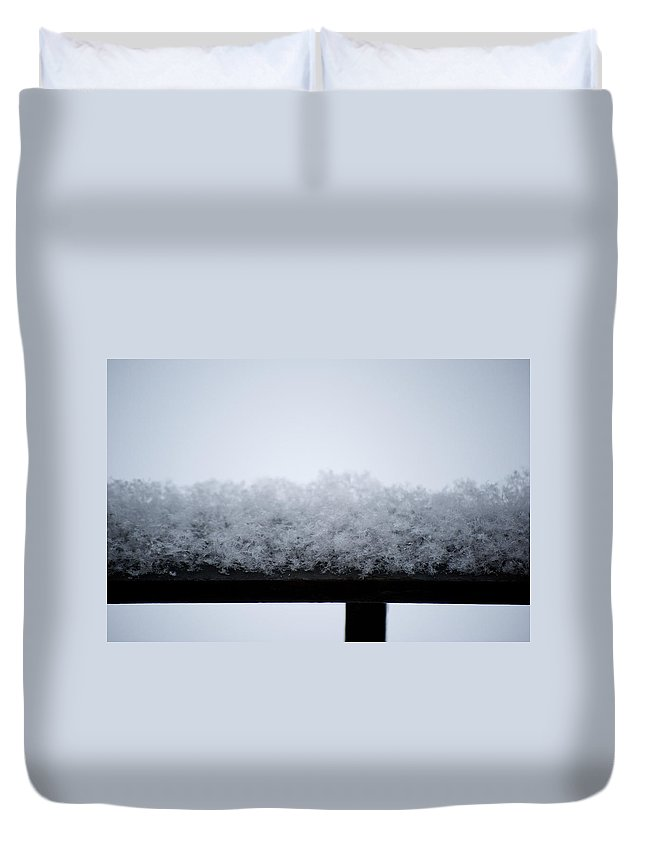 Iron Duvet Cover featuring the photograph Snowflakes Chill The Iron by Lisa Knechtel