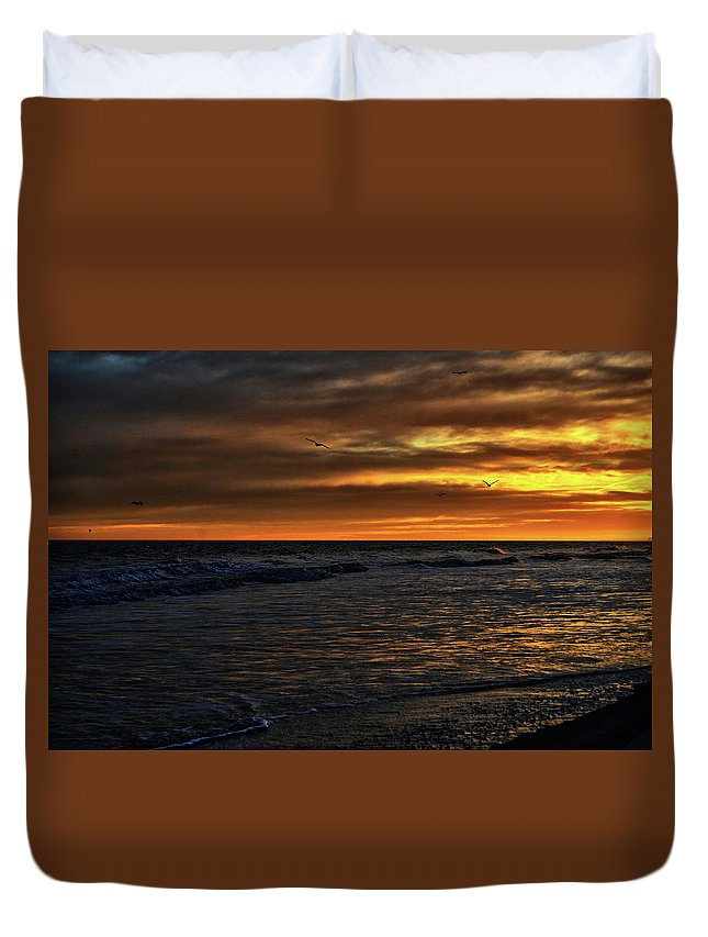 Atlantic Duvet Cover featuring the photograph Soaring In The Sunset by Kelly Reber