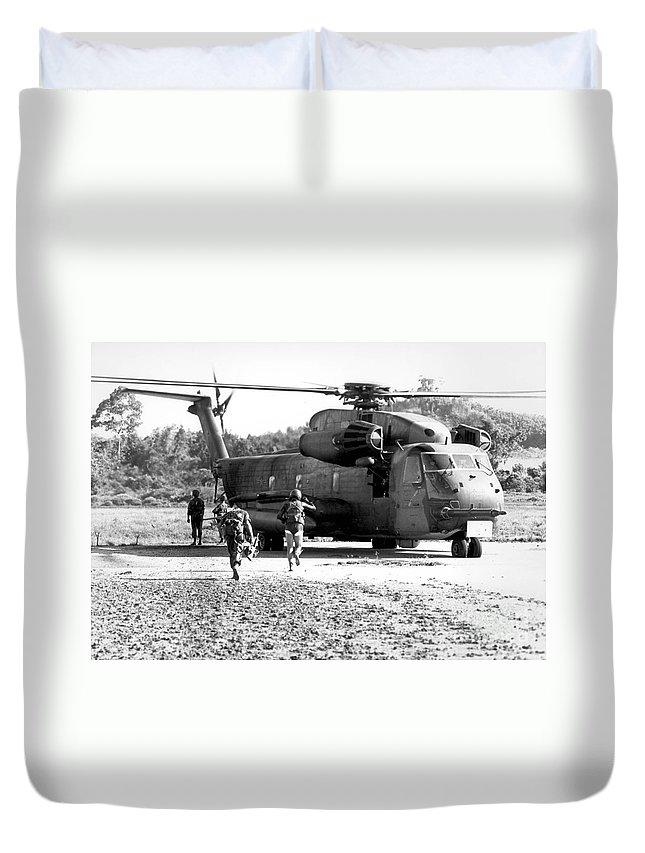 Pararescuemen Duvet Cover featuring the photograph Soldiers Run To A Hh-53c Helicopter by Stocktrek Images