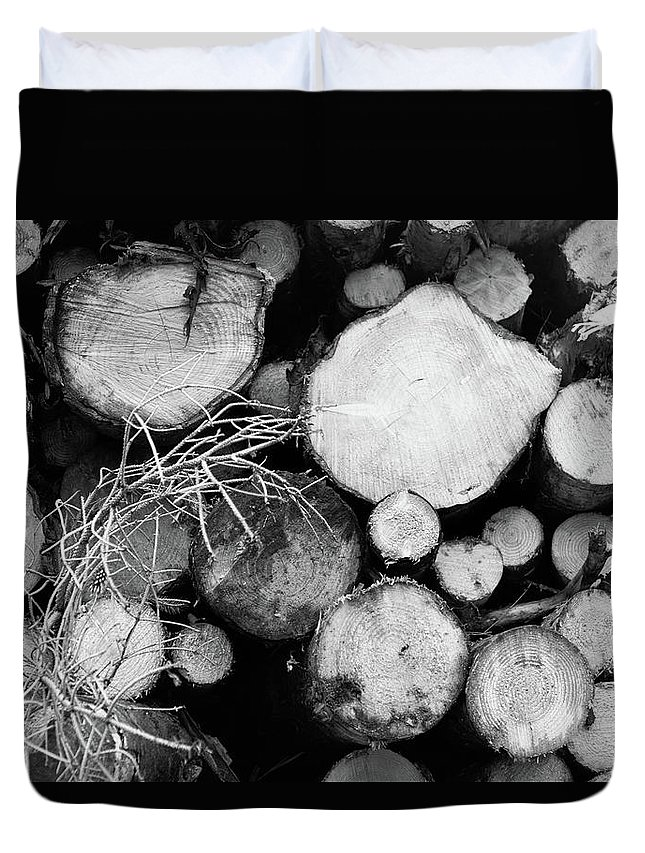 Cumbria Lake District Duvet Cover featuring the photograph Stacked Wood Logs In Black And White by Iordanis Pallikaras
