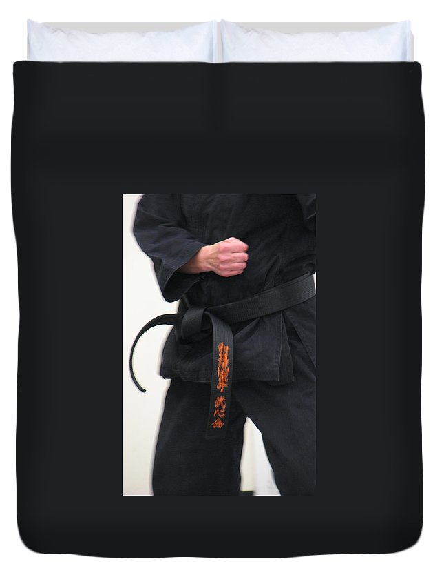 Karate Duvet Cover featuring the photograph Stands With Fist by Kelly Mezzapelle