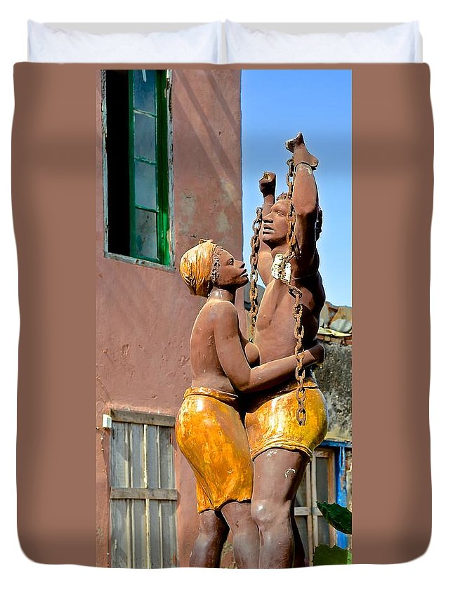 Statue Duvet Cover featuring the photograph Statue Dedicated To Slaves by Clifton Facey