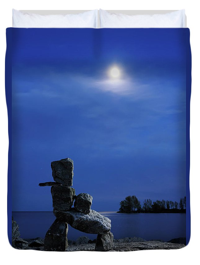 Inukshuk Duvet Cover featuring the photograph Stone Figure In Moonlight by Oleksiy Maksymenko