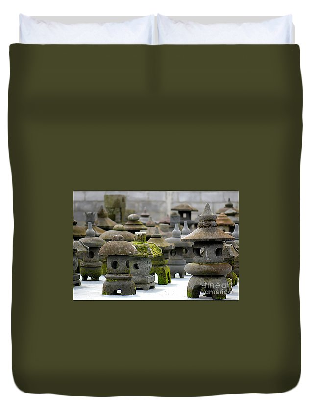 Figures Duvet Cover featuring the photograph Stone Figures by Charuhas Images