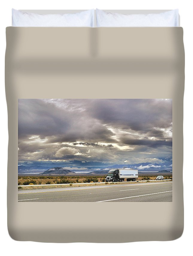 Desert Duvet Cover featuring the photograph Storm Clouds Over The Highway by Bill Mollet