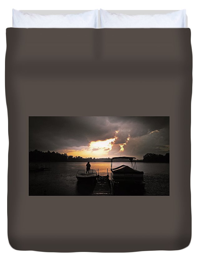 Storm Duvet Cover featuring the photograph Stormy Sunset by Graesen Arnoff