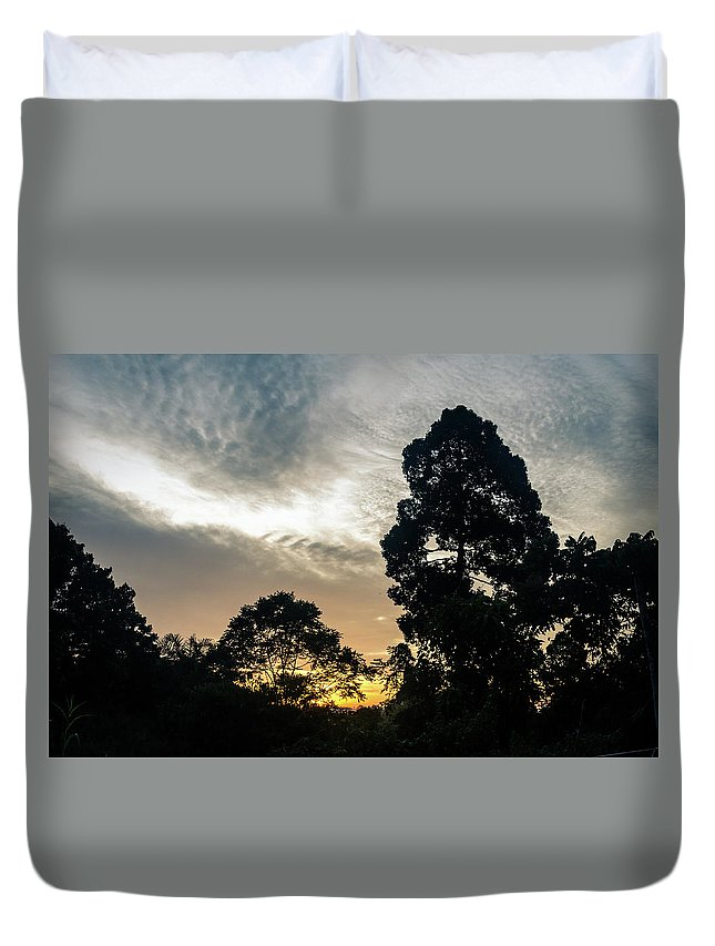 Borneo Duvet Cover featuring the photograph Sunrise Silhouettes by Richard Parsons