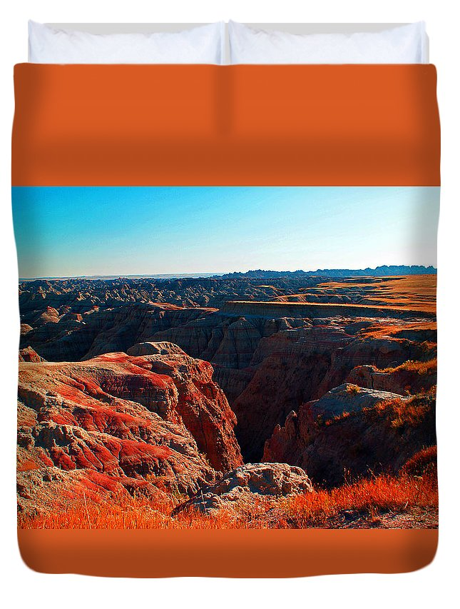 Badlands National Park Landscape Duvet Cover featuring the photograph Sunset In The Badlands by Glenn W Smith