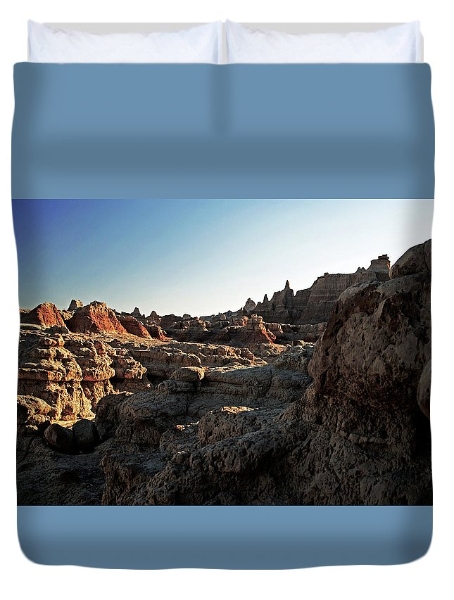 Badlands National Park Duvet Cover featuring the photograph Sunset Shadows In The Badlands by Glenn W Smith