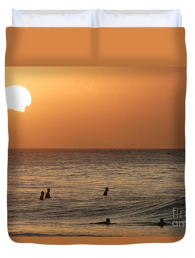 Calm Duvet Cover featuring the photograph Surfers At Sunset by Vince Cavataio - Printscapes