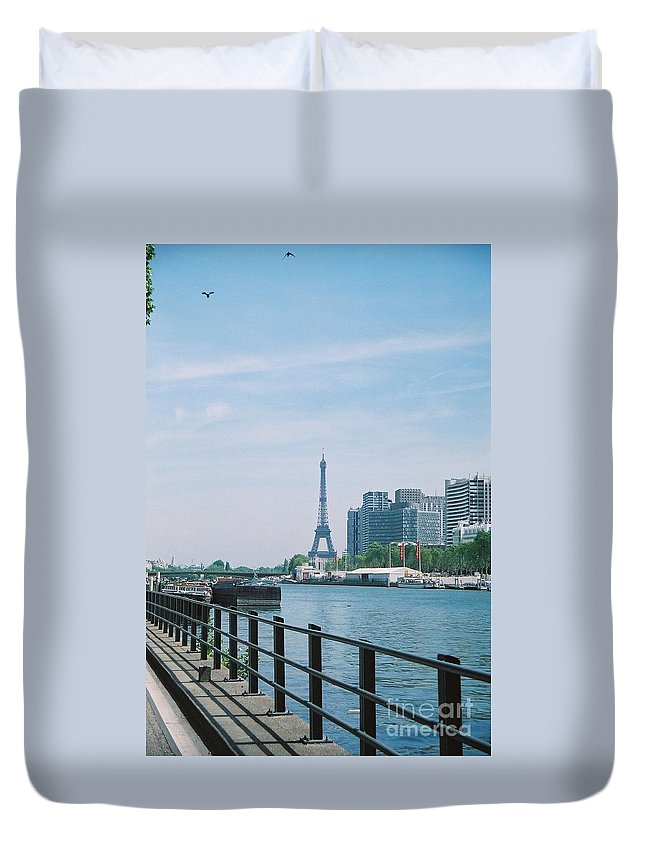 The Eiffel Tower Duvet Cover featuring the photograph The Eiffel Tower And The Seine River by Nadine Rippelmeyer