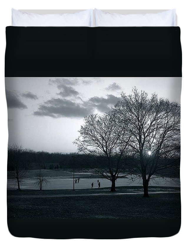 Holy Duvet Cover featuring the photograph The Ice Skaters...kirby Park Pond Kingston Pa. by Arthur Miller