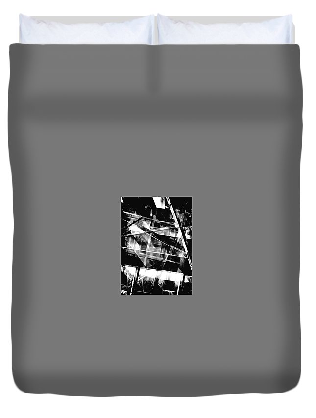 Abstract Duvet Cover featuring the photograph The Inner Works by Tom Gowanlock