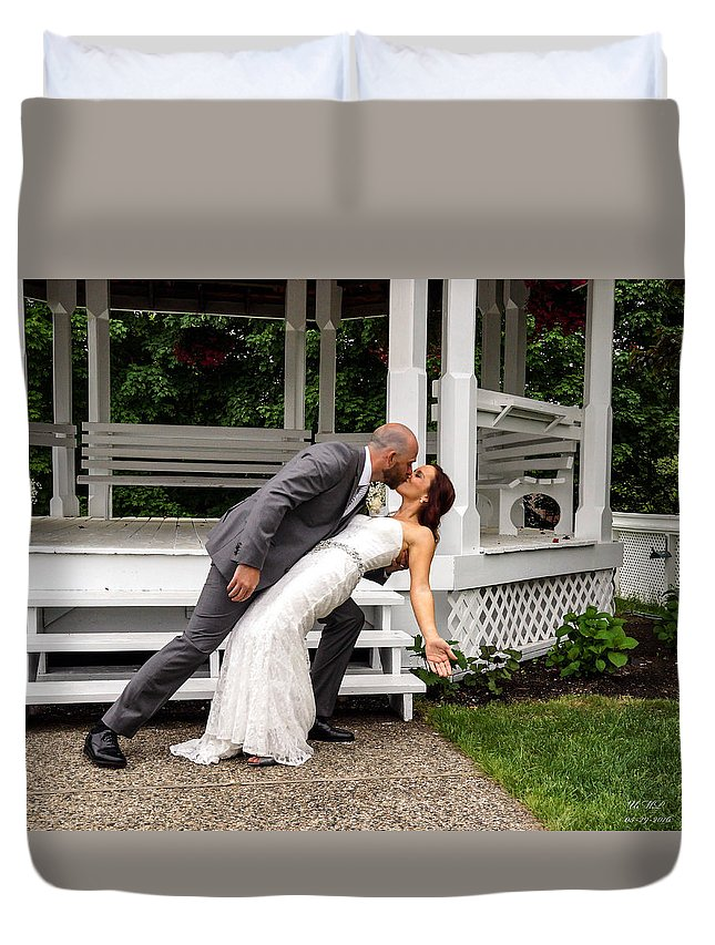 Wedding Duvet Cover featuring the photograph The Kiss by Mike Poland