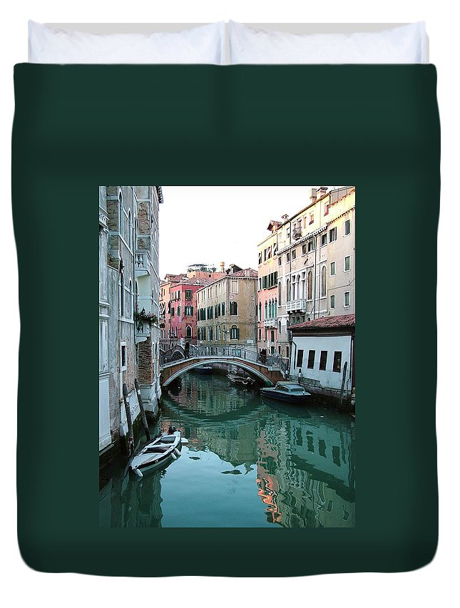 Landscape Duvet Cover featuring the photograph The Leaning Boat by Donna Corless